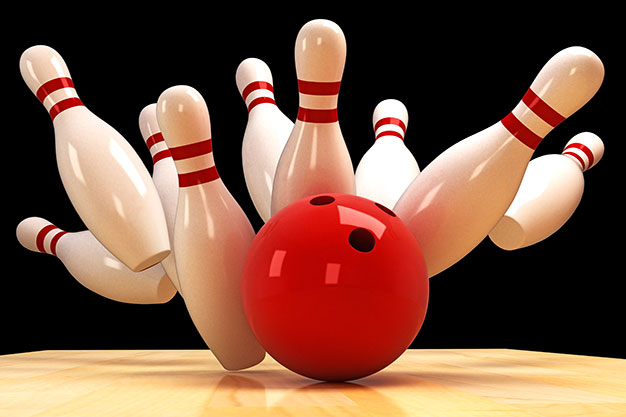 bowling ball and pins strike!