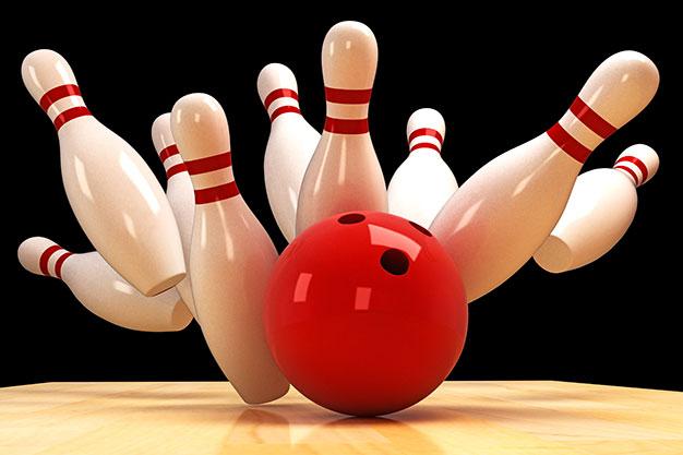 bowling ball and pins strike!